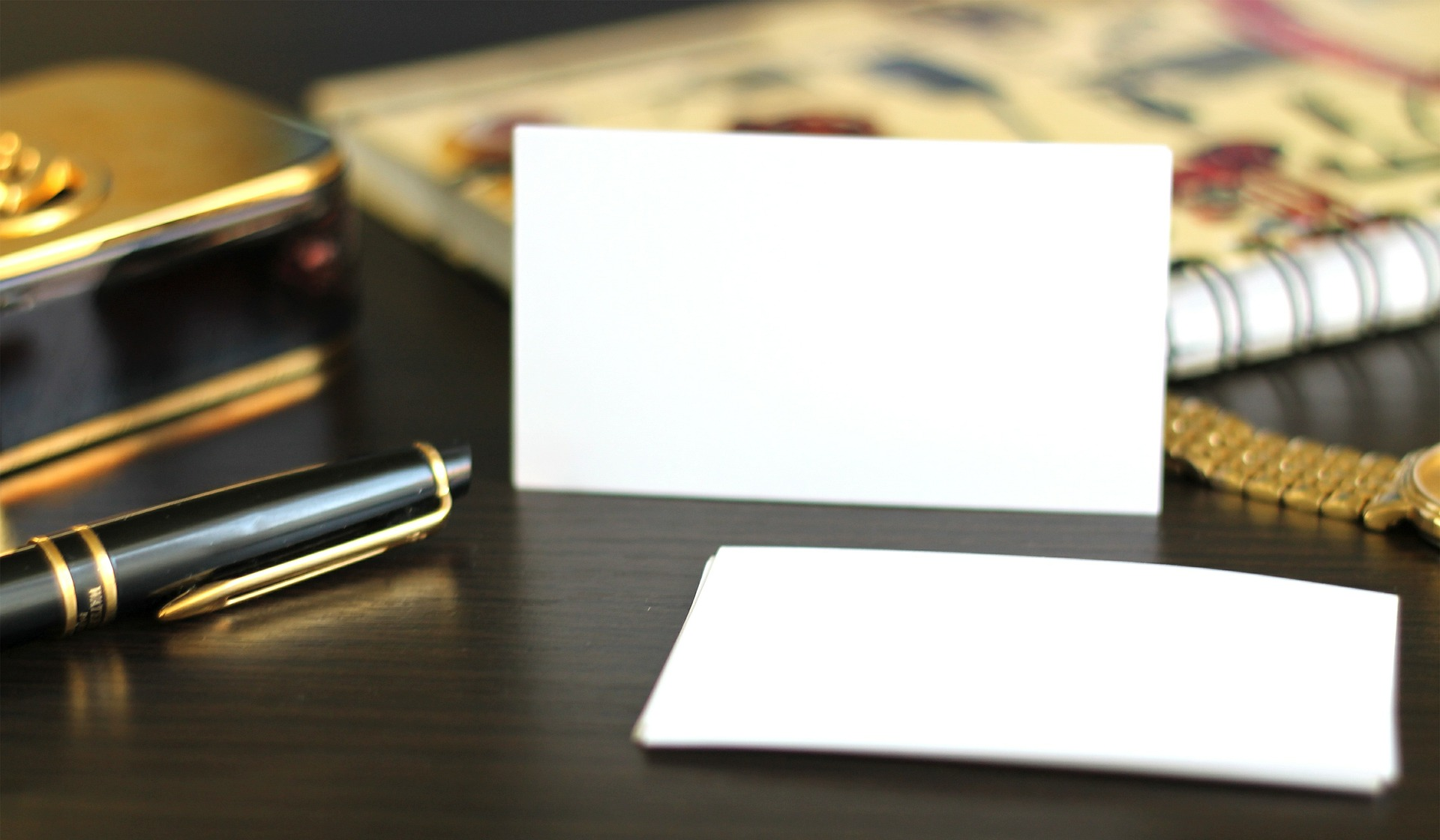 an office desk with a business card